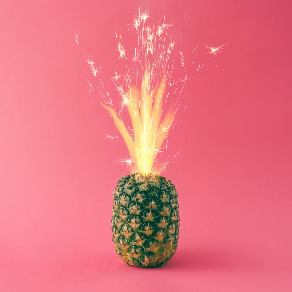 Pineapple with party cake sparkles. Minimal food concept.