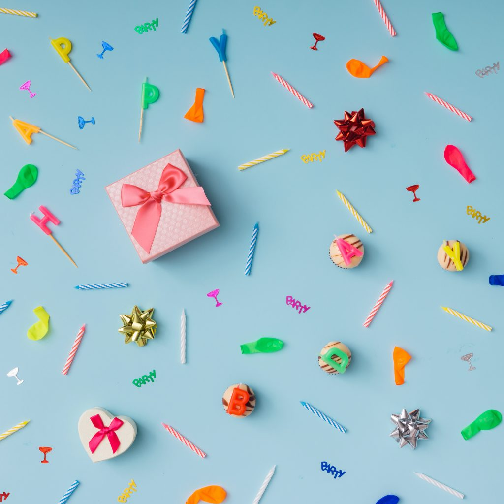 Pattern made of birthday party things. Flat lay.